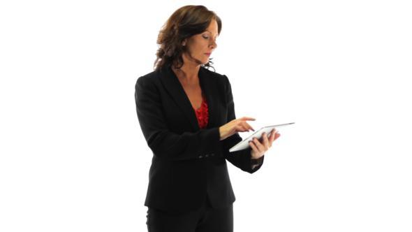 Anxious Businesswoman Using A Tablet