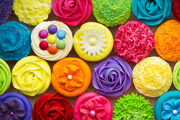 Array of colorful cupcakes