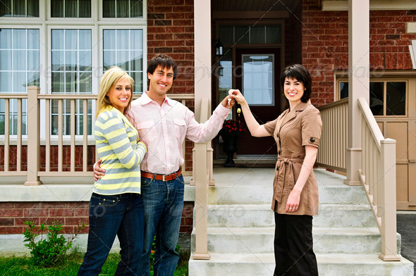 PhotoDune Happy Couple With Real Estate Agent 197580