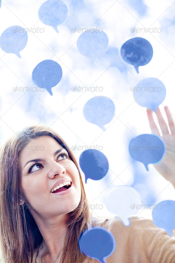 Woman with thought bubbles - Stock Photo - Images