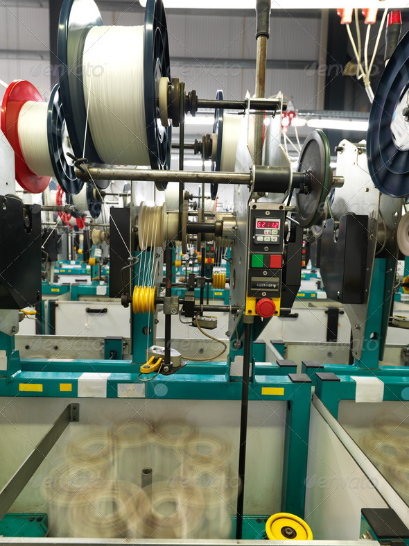 detail of thread factory production line - Stock Photo - Images