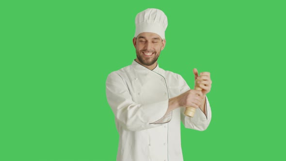 VideoHive Mid Shot of a Chef Spicing Up Dishes with Peppe Box Background is Green Screen 19462288