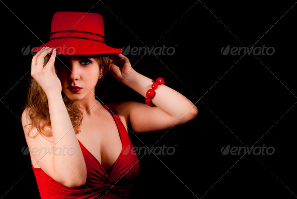 Portrait of woman with a red hat - Stock Photo - Images