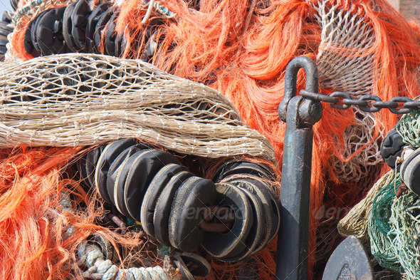 Big pile of fishing nets and an anchor - Stock Photo - Images