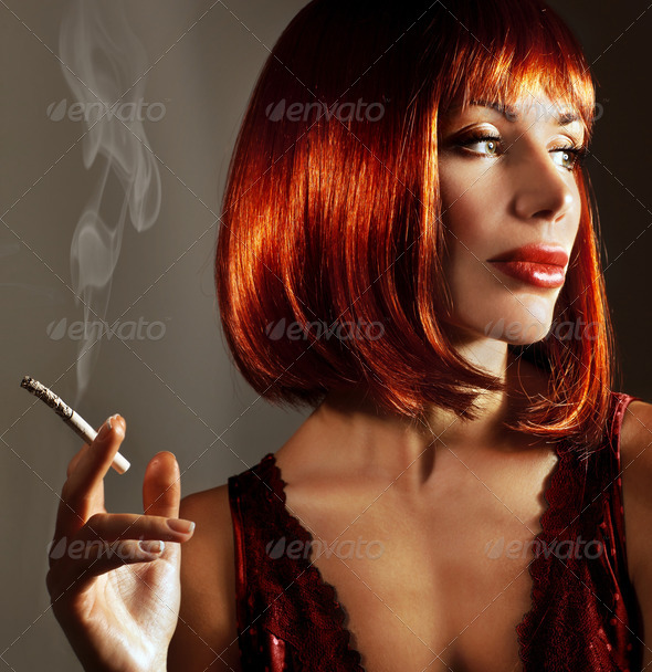 Luxury close up portrait of attractive girl with cigaret - Stock Photo - Images