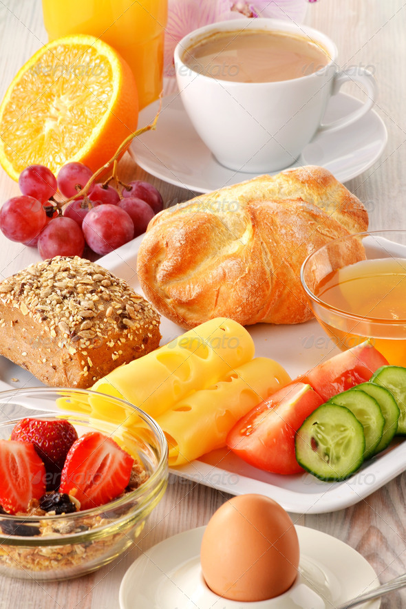 Breakfast with coffee, rolls, egg, orange juice, muesli and chee - Stock Photo - Images