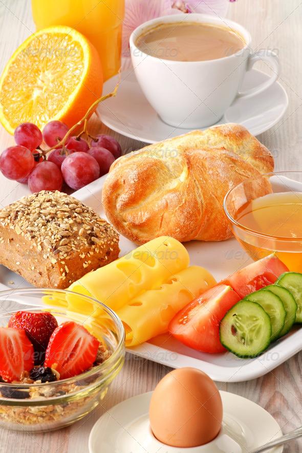Breakfast with coffee, rolls, egg, orange juice, muesli and chee - Stock Photo - Images