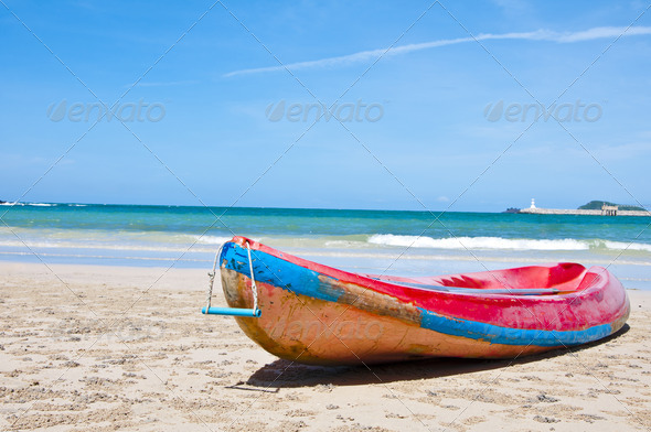 Red kayak on the beach with blue sky , Eastern of Thailand - Stock Photo - Images
