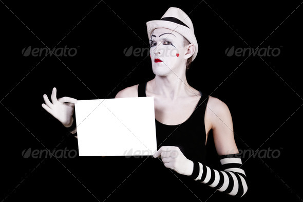 mime in striped gloves and white hat holding white blank - Stock Photo - Images
