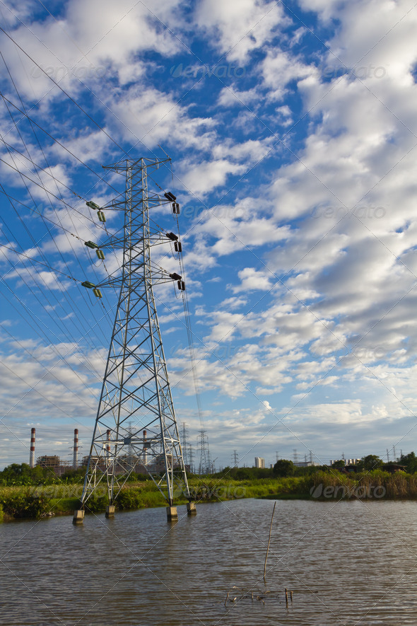 High voltage power transmission lines and pylons - Stock Photo - Images