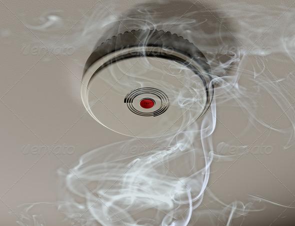PhotoDune Smoke alarm in a smoky room 2846165