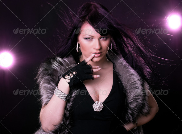 Woman in fur coat - Stock Photo - Images
