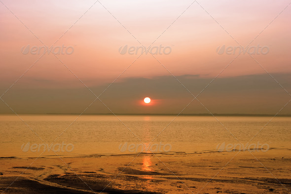 A sunset over the beach - Stock Photo - Images