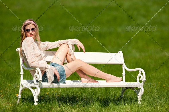 Spring   Young Woman Relaxing On Bench In Meadow - Stock Photo - Images