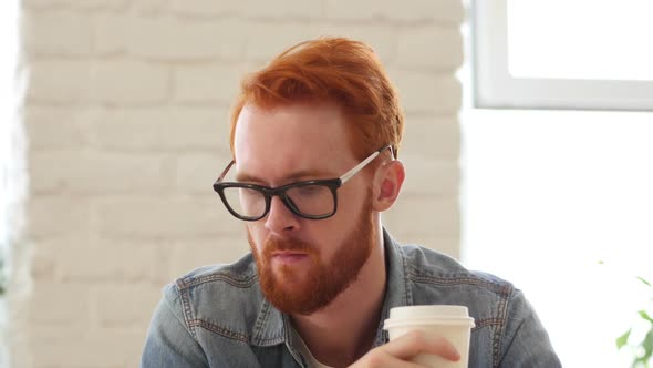Download Man w/ Beard, Red Hairs Drinking Coffee, Tea in Office, Portrait nulled download