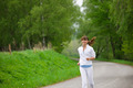 Jogging   Sportive Woman Running On Road In Nature
