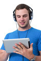 Young man with headphones working on a tablet pc - PhotoDune Item for Sale