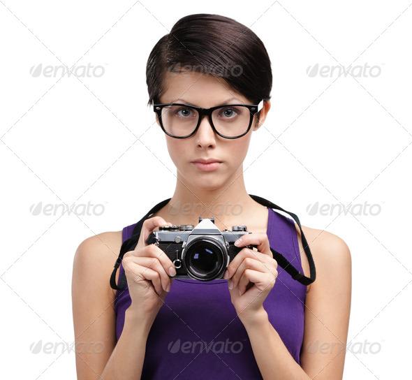 Pretty girl hands retro photographic camera - Stock Photo - Images