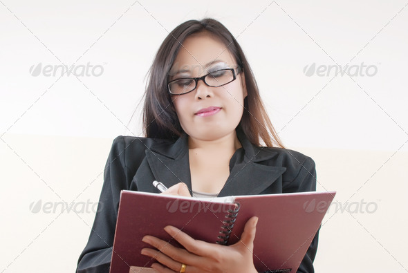 Business Lady write on notebook. - Stock Photo - Images