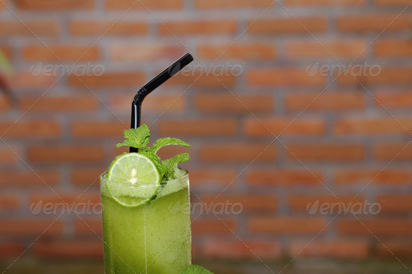 mint smoothie with lime in glass - Stock Photo - Images