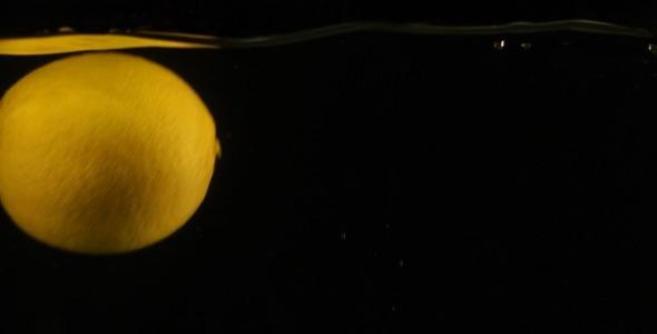 Fresh Lemon Falling in Water Slow Motion