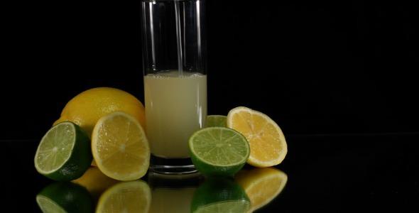 Pouring Citrus Juice on Black