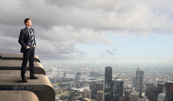 Businessman and cityscape - Stock Photo - Images