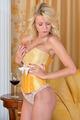 Beautiful woman in yellow underwear in luxury interior.