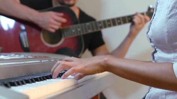 Download Guitarist And Pianist Playing nulled download