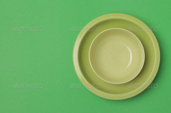 top shot green bowl and plate on green background - Stock Photo - Images