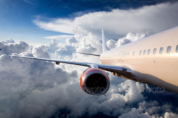Airplane in Sky - Stock Photo - Images