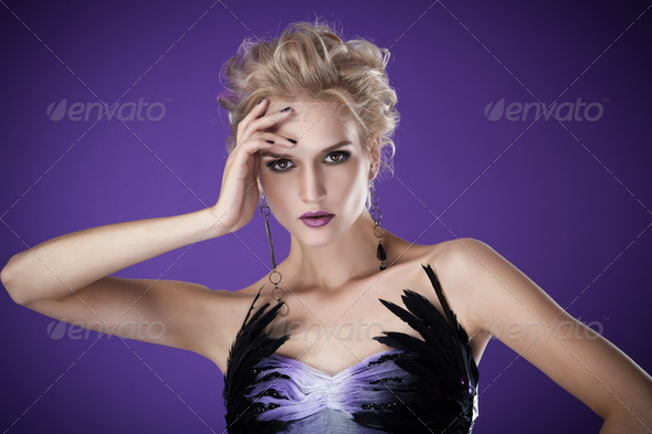 The Image Of A Beautiful Luxurious Woman On Purple Background. Studio Shot - Stock Photo - Images