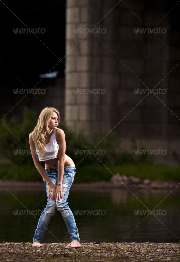 Young Sexy Woman In Jeans At The River - Stock Photo - Images