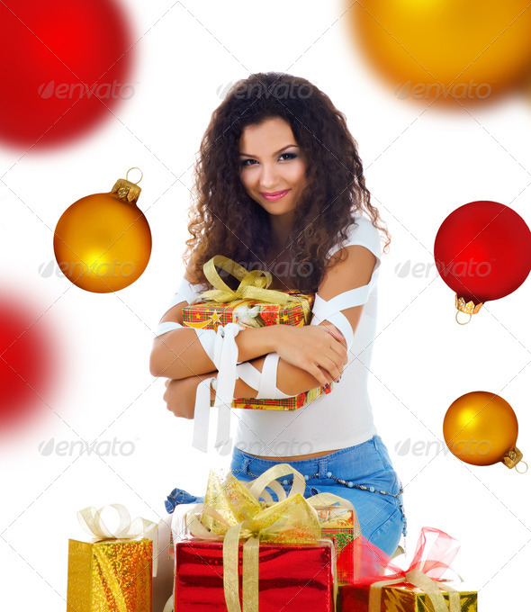 Pretty woman with a christmas gifts on a spheres background - Stock Photo - Images
