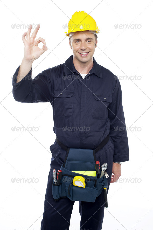 Senior repairman showing good work done sign - Stock Photo - Images