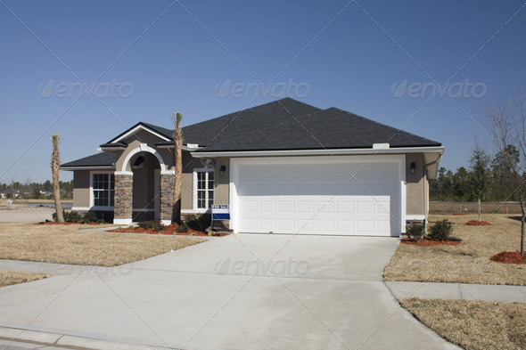 Beige Home With Earthtone Stone Accents Stock Photo
