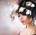 Fashion Brunette Girl with Magnolia Flowers. Hairstyle - PhotoDune Item for Sale