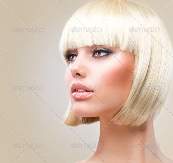 Haircut. Beautiful Girl with Healthy Short Blond Hair. Hairstyle - Stock Photo - Images