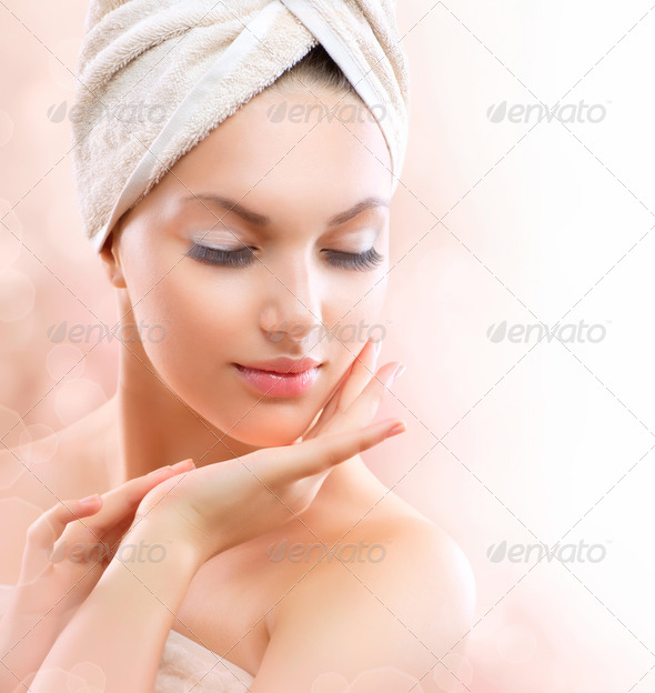Spa Girl. Beautiful Young Woman After Bath Touching Her Face - Stock Photo - Images