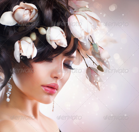 Fashion Brunette Girl with Magnolia. Hairstyle - Stock Photo - Images