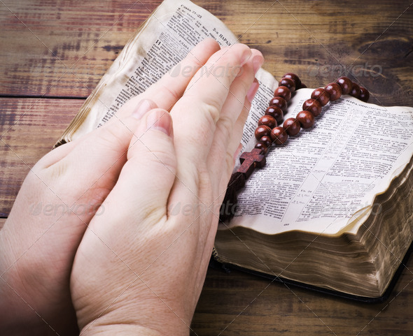 human hands holding the Bible and praying - Stock Photo - Images