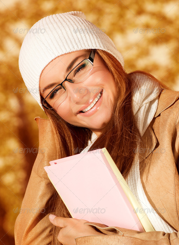 Student female in autumn park - Stock Photo - Images