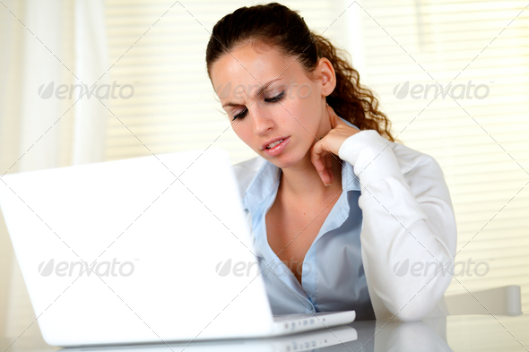 Young woman interested reading the laptop screen - Stock Photo - Images