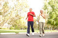 Senior Couple Jogging In Park - PhotoDune Item for Sale