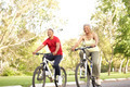 Senior Couple Riding Bikes In Park - PhotoDune Item for Sale
