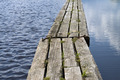 Wooden path floating on calm water - PhotoDune Item for Sale