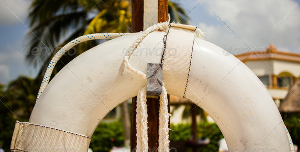 Close Life Preserver Hanging on a pole  - Stock Photo - Images