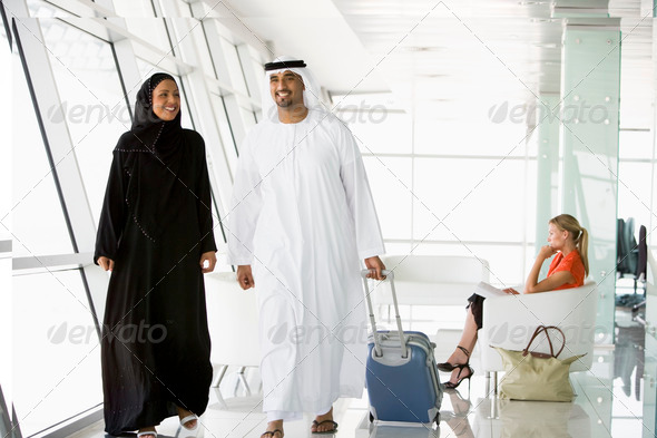 Stock Photo - PhotoDune Couple walking through airport departure lounge 312105