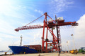 Moored container ship and cranes in a harbor - PhotoDune Item for Sale