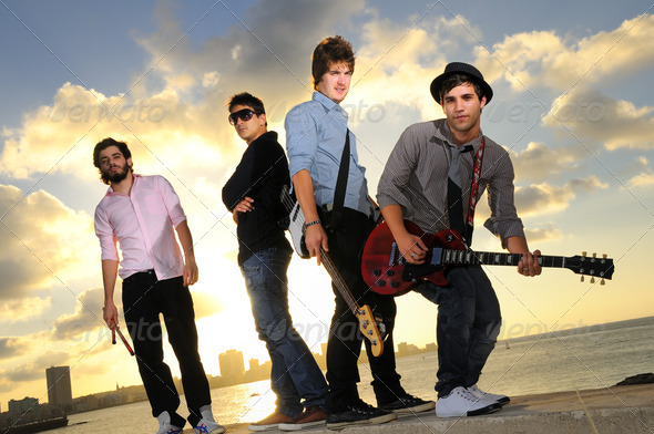 Band of young male musicians with instruments - Stock Photo - Images